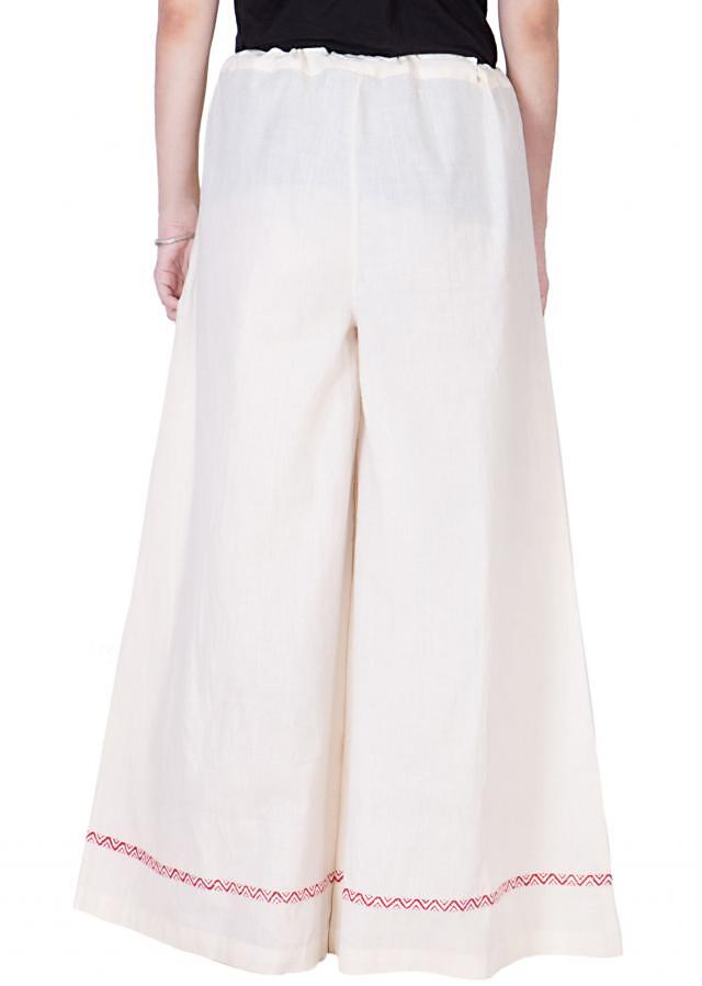 off white cotton pants with drawstrings and red block print