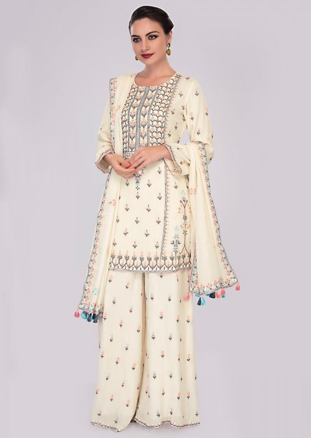 Off white cotton suit and palazzo in embroidery and butti only on Kalki