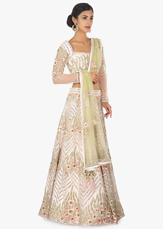 Off White Lehenga And Blouse In Embellished Satin Net Paired With A Light Green Net Dupatta Online - Kalki Fashion