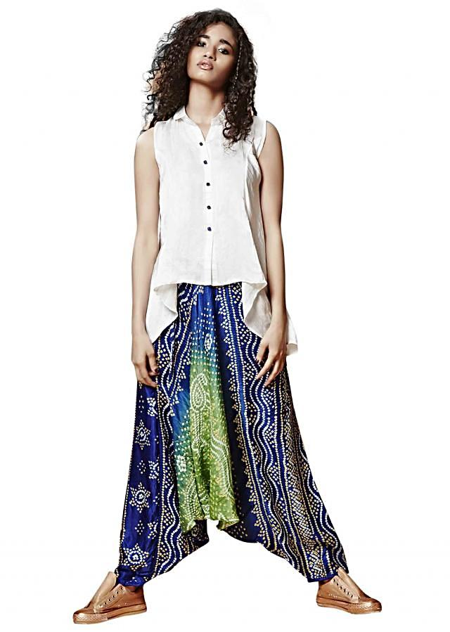 Off white flared kurti matched with bandhani pant only on Kalki