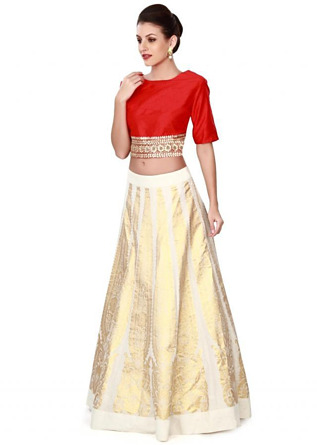 Off white lehenga matched with red crop top blouse only on Kalki