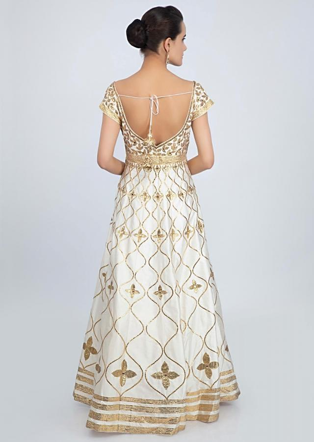 Off White Anarkali Suit In Raw Silk With Golden Embroidery Online - Kalki Fashion