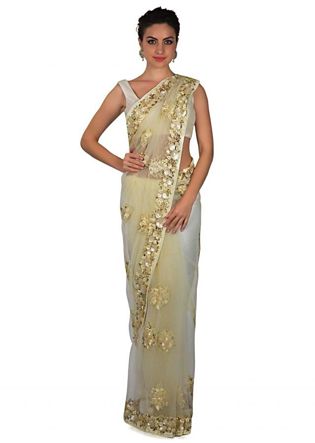 Off white saree adorn in sequin butti and border only on Kalki