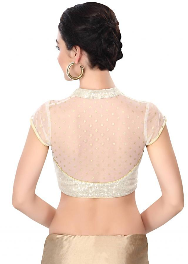 Off white saree enhanced in sequin embroidery only on Kalki