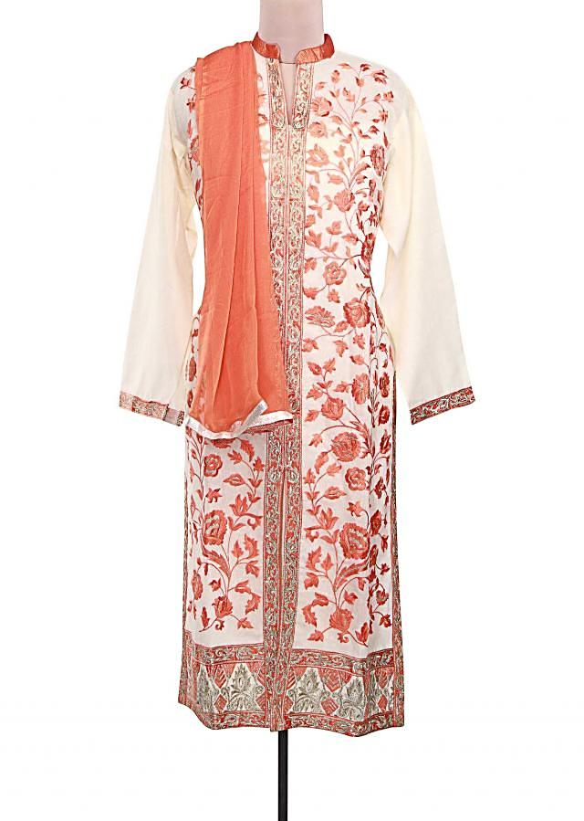 Off white semi stitched suit adorn in floral motif resham embroidery only on Kalki
