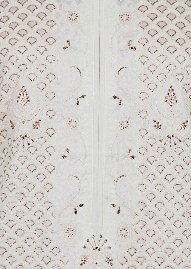 Off white semi stitched suit in thread and zari embroidery only on Kalki