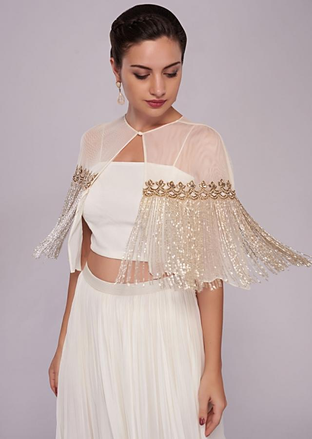 White georgette skirt with crop top blouse and tassel embroidered cape only on Kalki