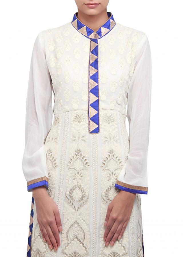 Off white straight fit suit enhanced in thread and zari embroidery only on Kalki