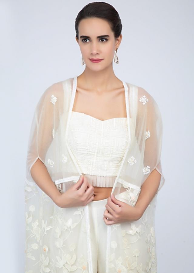 Off White Strap Crop Top With Matching Sharara And Embroidered Net Jacket Online - Kalki Fashion