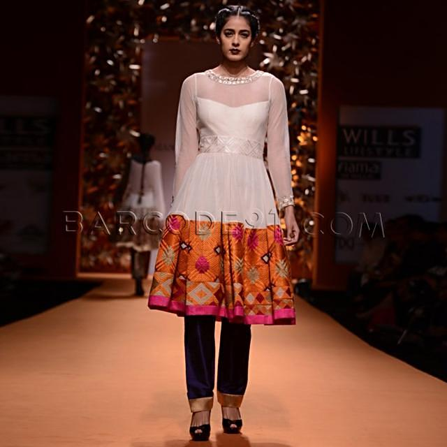 Off white suit with broad geometric embroidered border