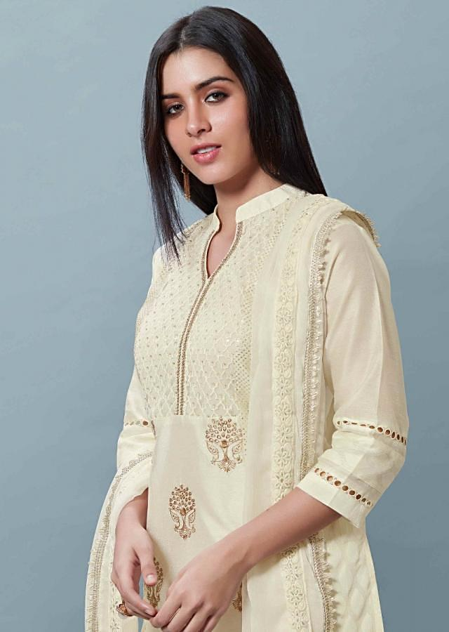 Off White Unstitched Cotton Suit Set With Embroidered Bodice And Floral Buttis Online - Kalki Fashion