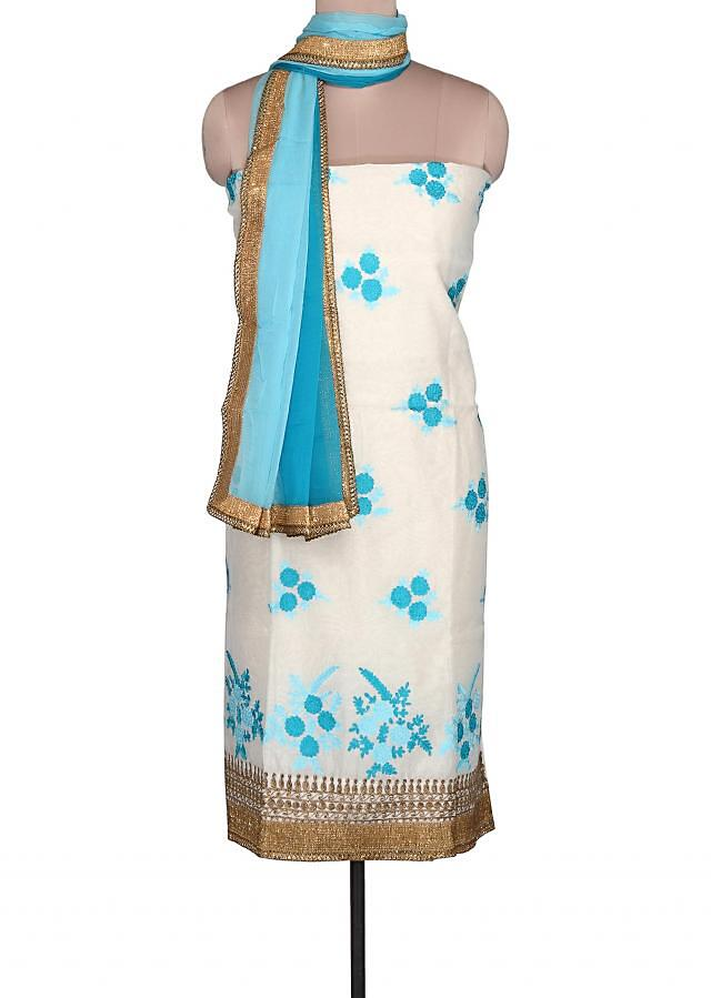 Off white unstitched suit adorn in blue resham embroidery only on Kalki