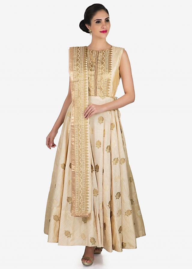 Off-white anarkali suit in silk showcasing the heavy zari embroidery work only on Kalki