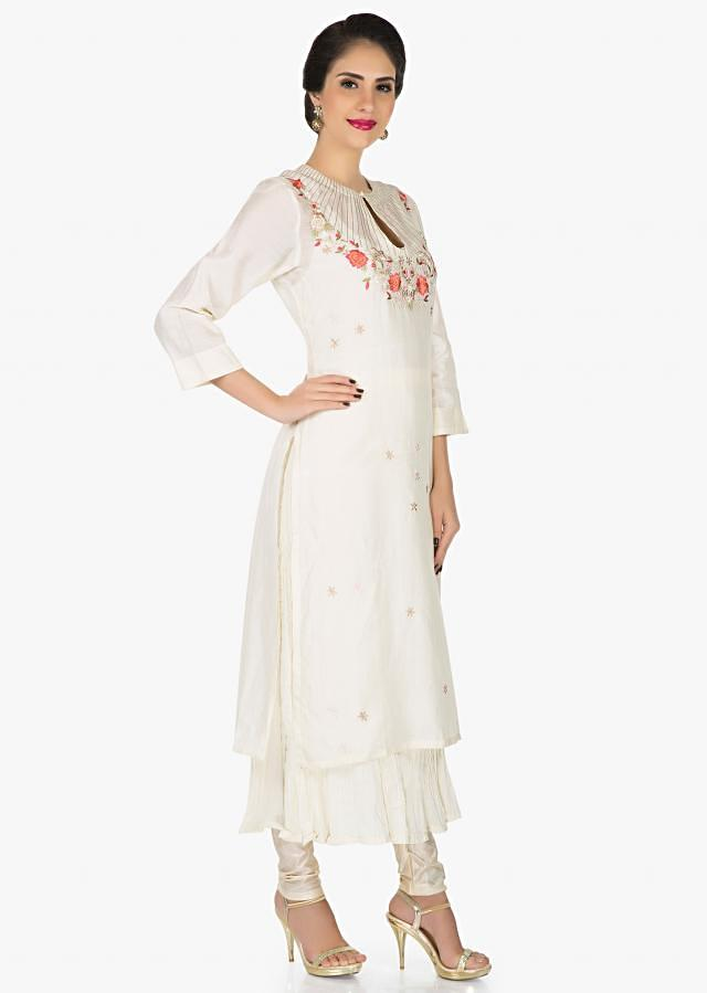 Off-white dress in crush cotton enhanced in resham embroidery only on Kalki