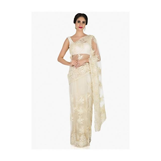 Off-white saree in net crafted in pretty thread work only on Kalki