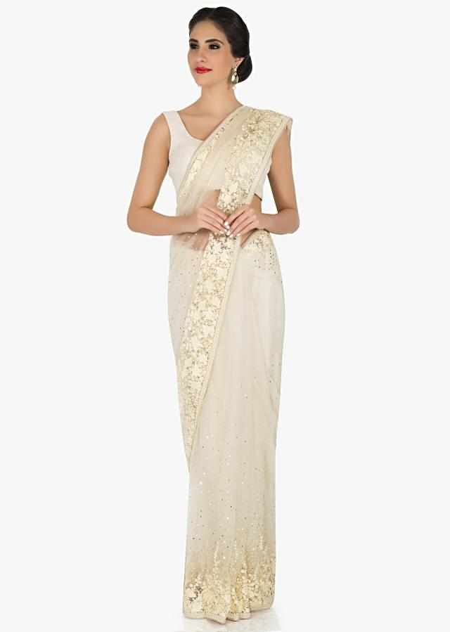 Off-white saree in net crafted with resham and sequin work only on Kalki