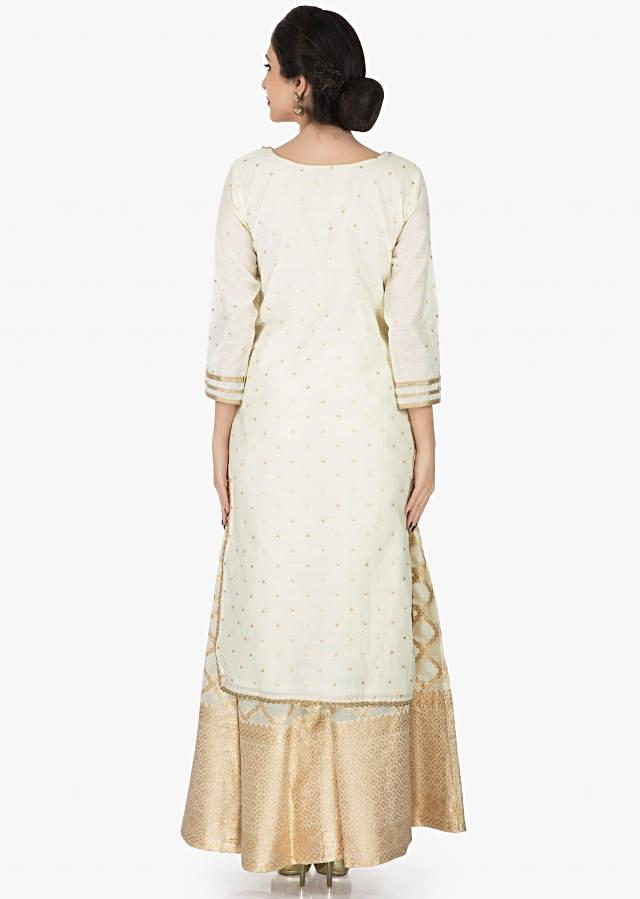 Off-white silk suit embellished in fancy stone work only on Kalki