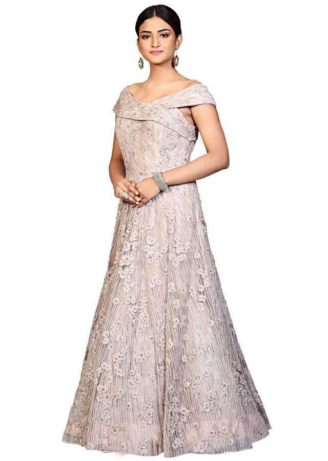 Off pink gown in embroidered net highlighted in sequin