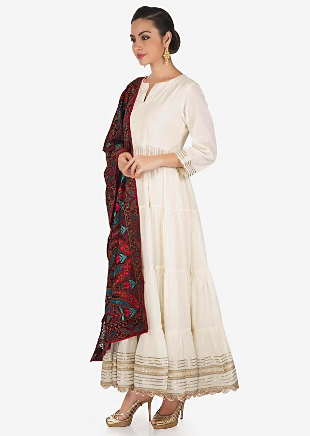 Off white anarkali suit highlighted in gotta lace and black phulkari dupatta only on Kalki