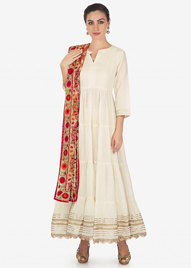 Off white anarkali suit highlighted in gotta lace and phulkari dupatta only on Kalki