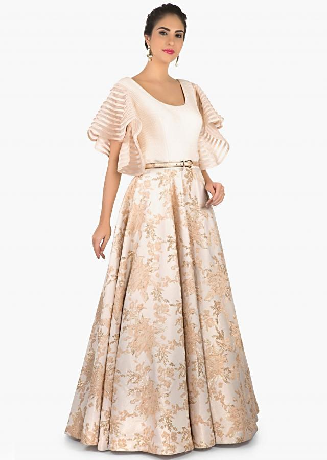 Off white and baby pink gown enhanced with brocade only on Kalki