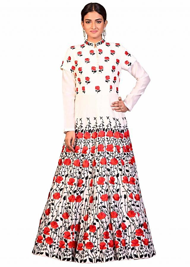 Off white gown in raw silk with resham embroidery in floral motif