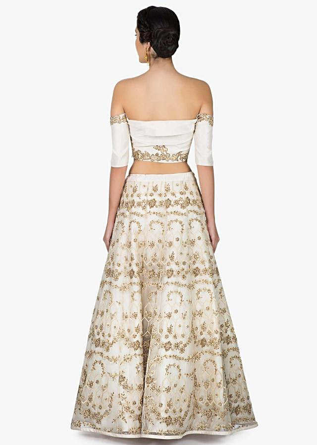 Off white lehenga with off shoulder blouse in zari and sequin embroidery only on Kalki