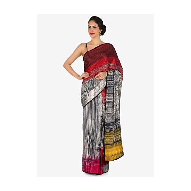 Off white, red and yellow shaded saree in print and kundan work only on Kalki
