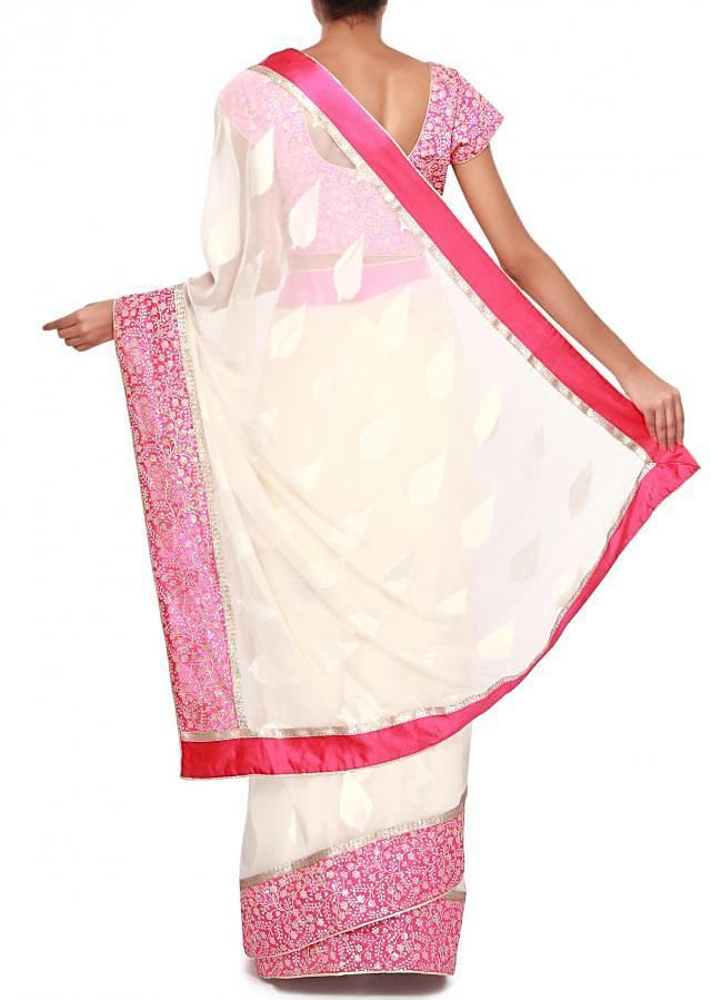 Off white shimmer saree adorn in weave and thread embroidery only on Kalki