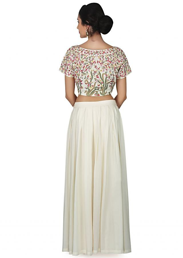 Off white skirt in georgette with crop top embroidered blouse only on Kalki