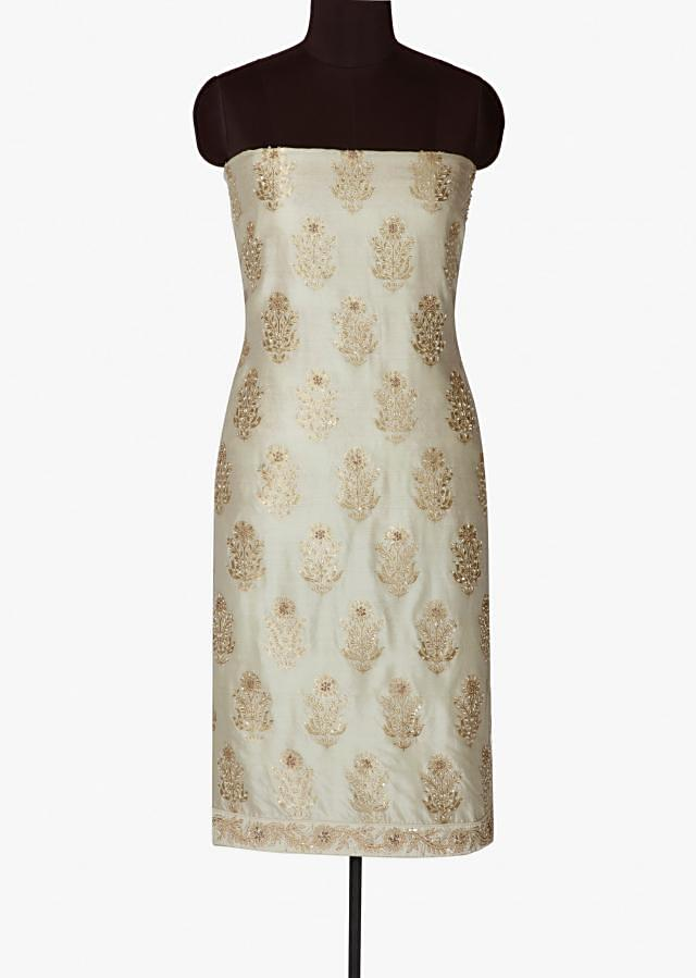 Off white unstitched brocade suit in   moti and sequin only on Kalki
