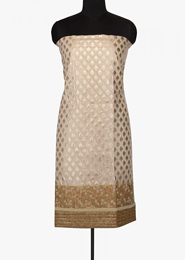 Off white unstitched suit in silk with embroidered hem line only on Kalki
