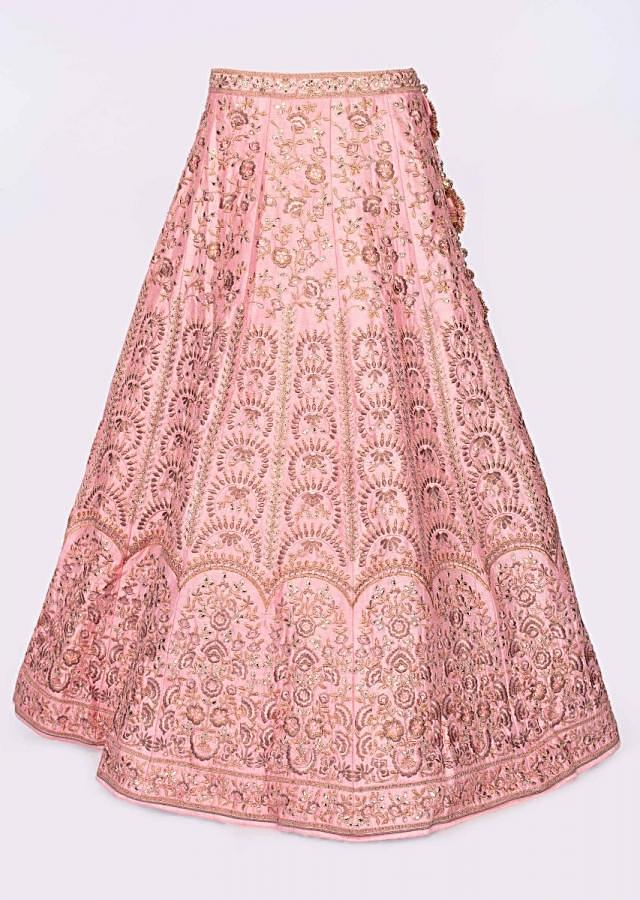 Olive green blouse paired with pink heavy embroidered lehenga and net dupatta only on Kalki