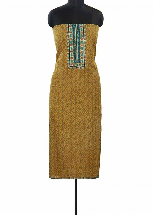 Olive green unstitched suit features with highlighted placket only on Kalki