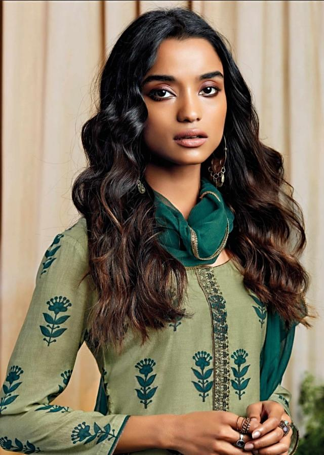 Olive green unstitched suit with thread and zari embroidered butti and placket