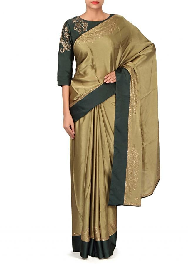 Olive saree embellished in kundan with ready blouse only on Kalki