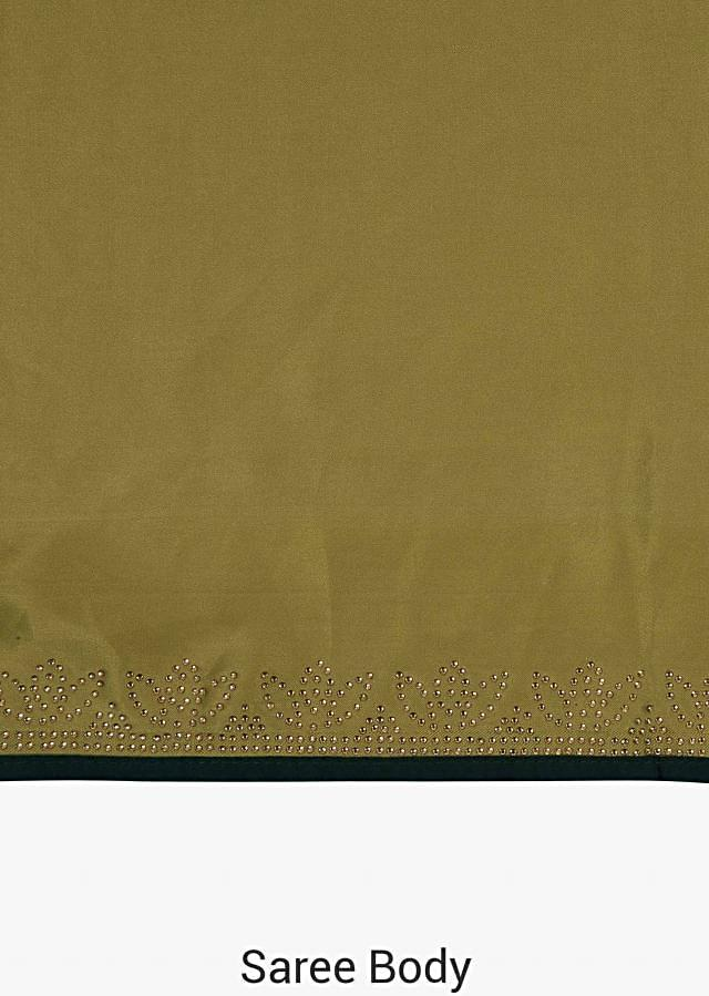 Olive green saree beautified with the kundan embroidery only on Kalki