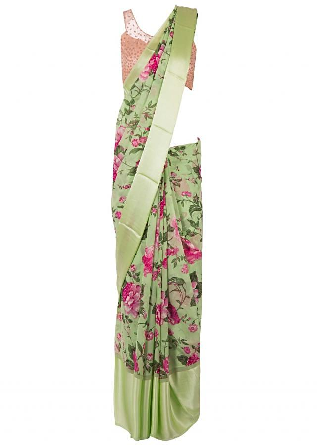 Olive green saree in satin with floral print only on Kalki