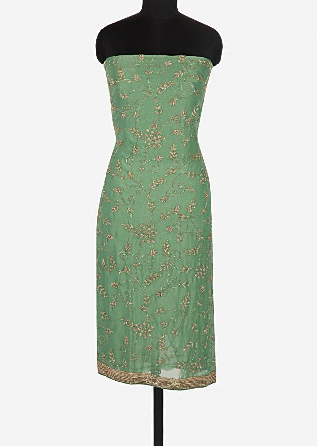 Olive green unstitched suit in shimmer georgette embellished in moti and cut dana work only on Kalki