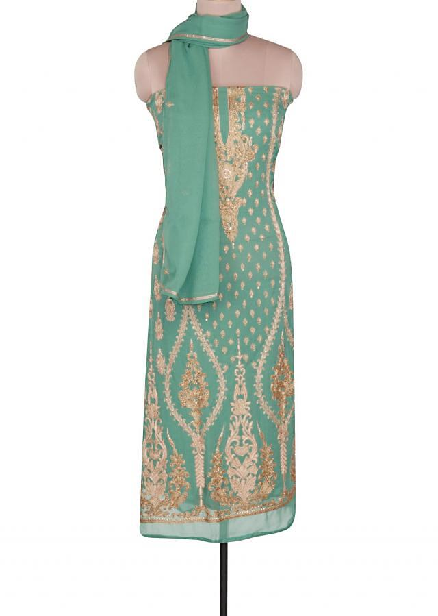 Olive unstitched suit adorn in kardana and resham embroidery only on Kalki
