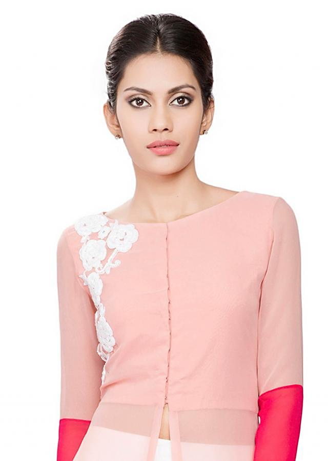 Onion pink tunic with coral cuffs and white embroidered armhole