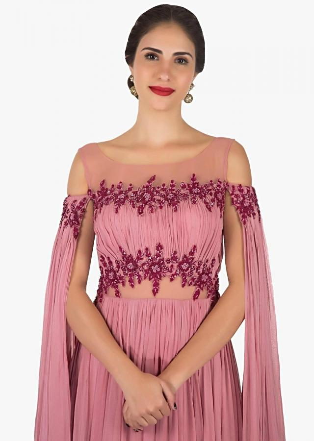 Onion pink gown in georgette crafted beautifully in frenchknot and sequin work only on Kalki