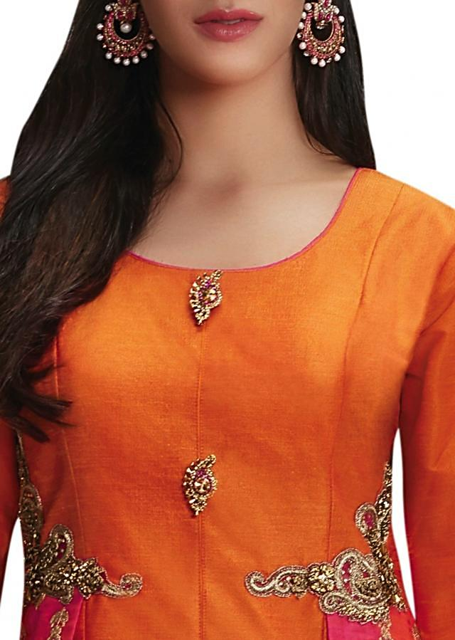 Orange A line suit in with rani pink zari embroidered kali