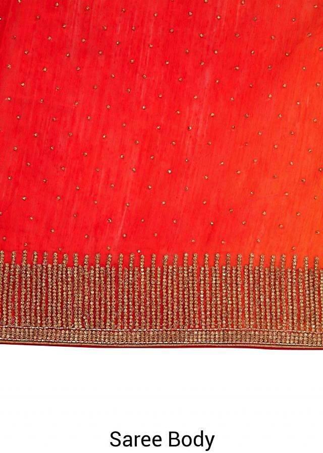 Orange and coral saree embellished in kundan embroidery only on Kalki