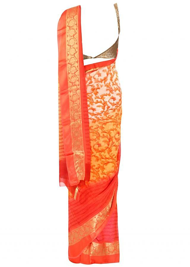 Orange and cream shaded saree in floral jall print only on Kalki