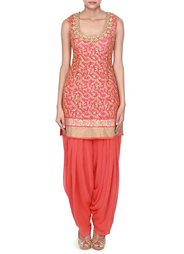 Orange and pink Patiala suit featuring with zari embroidery only on Kalki
