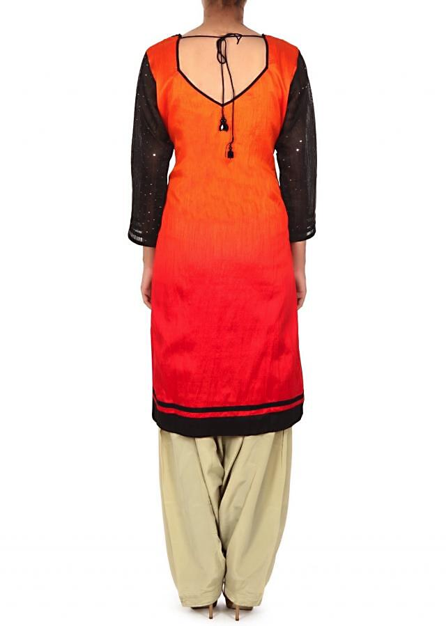 Orange and red suit featuring in applique embroidery only on Kalki