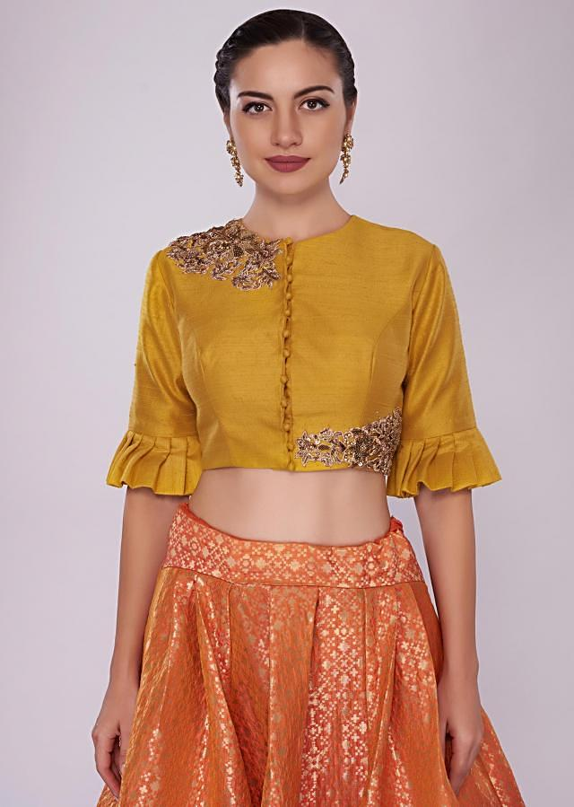 Orange brocade skirt  paired with a chrome yellow raw silk crop top only on Kalki