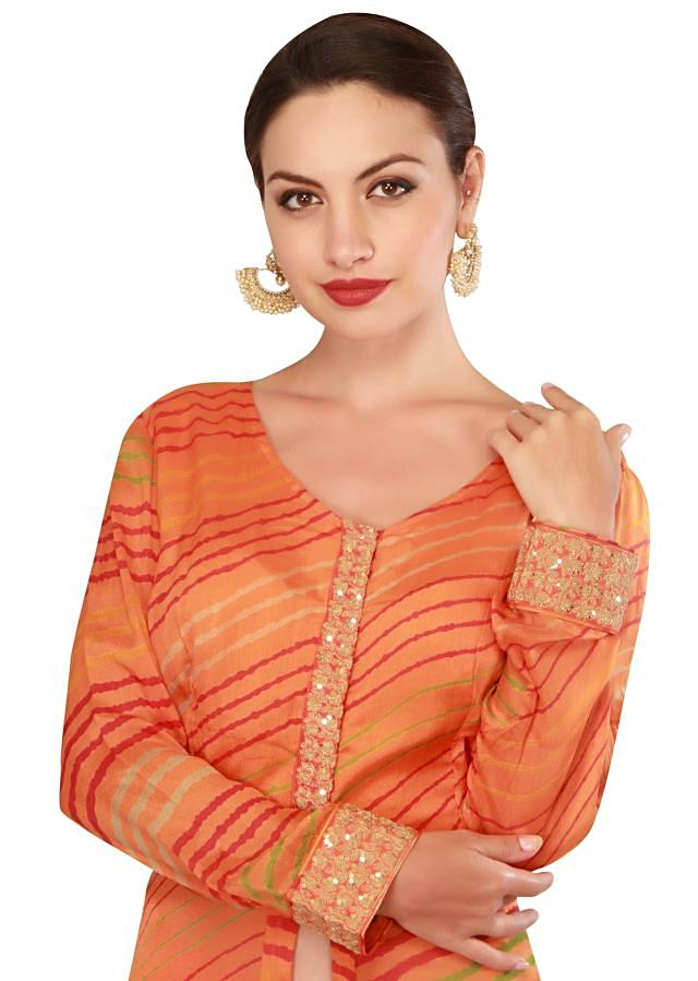 Orange fancy suit with palazzo pant only on Kalki
