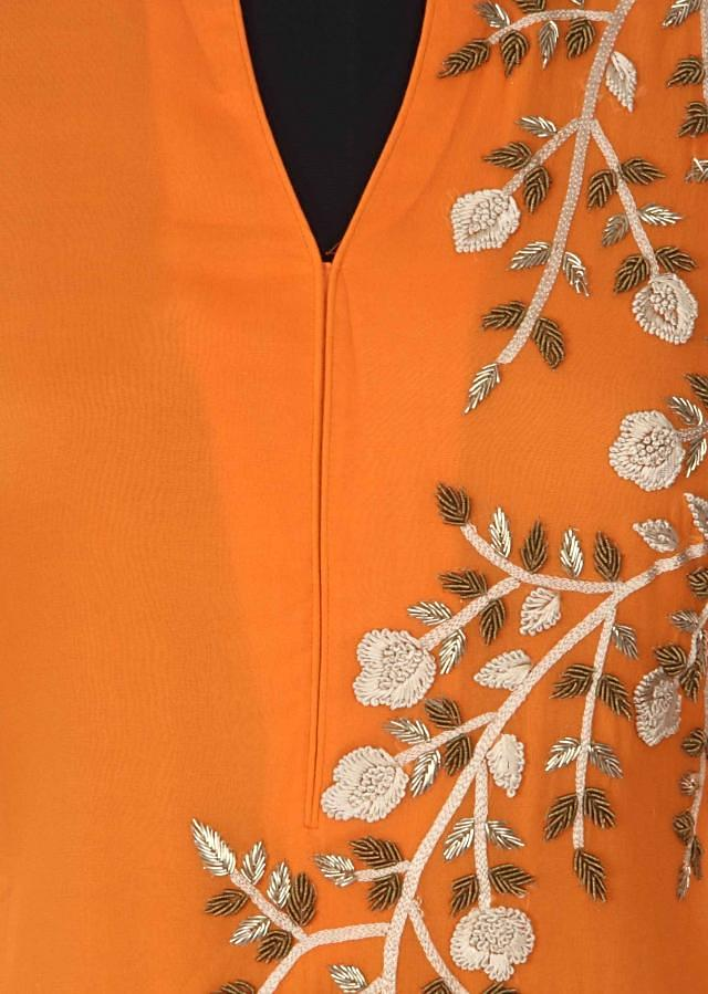 Orange kurti adorn in zardosi and french knot embroidery only on Kalki